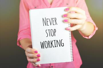 woman-holding-never-stop-working-print-notebook-684363